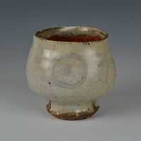 A small wood-fired bowl (or cup) with slip decoration