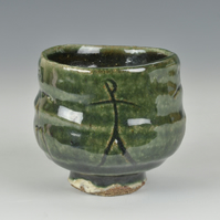A cup or bowl, with Oribe glaze over white slip