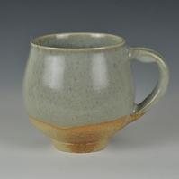 A stoneware cup with celadon glaze