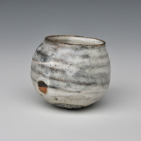 A stoneware, round-bottomed cup or bowl