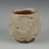A stoneware cup with matte, shino glaze