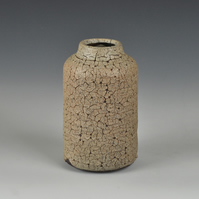 A stoneware bottle vase with matte, crackle glaze