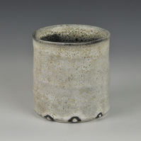 A stoneware pot with dolomite glaze