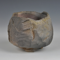 "A carved, wood-fired tea bowl or ""chawan"""