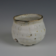 A stoneware cup or bowl with dolomite glaze