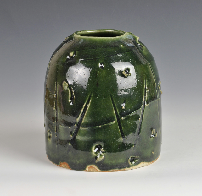 A decorative stoneware vase with incised decoration and Oribe glaze