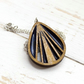 Iridescent navy recycled eyeshadow resin and golden oak coloured wood necklace