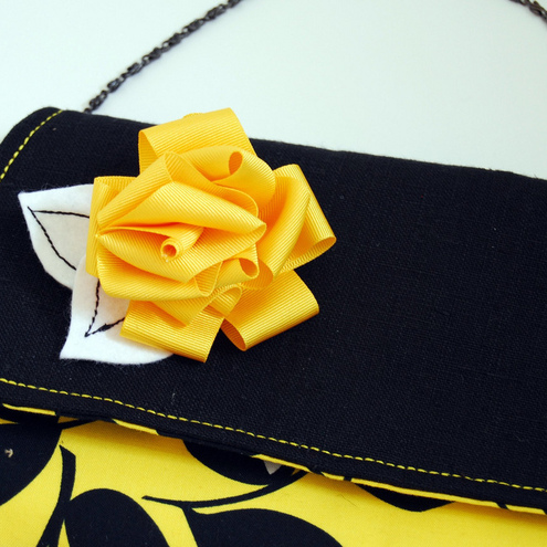 Esther fold-over clutch - Laughing leaf yellow with corsage