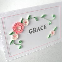 Quilled birthday card with name and flowers