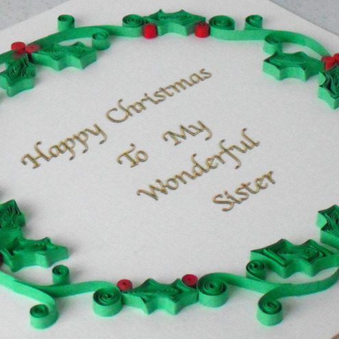 Quilled personalised Christmas card with quilling holly garland