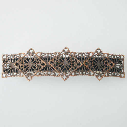 Filigree copper coloured hair clip