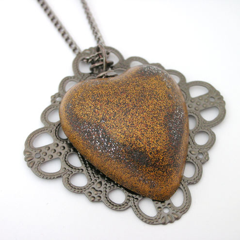 Antique gold coloured resin heart pendant with chain