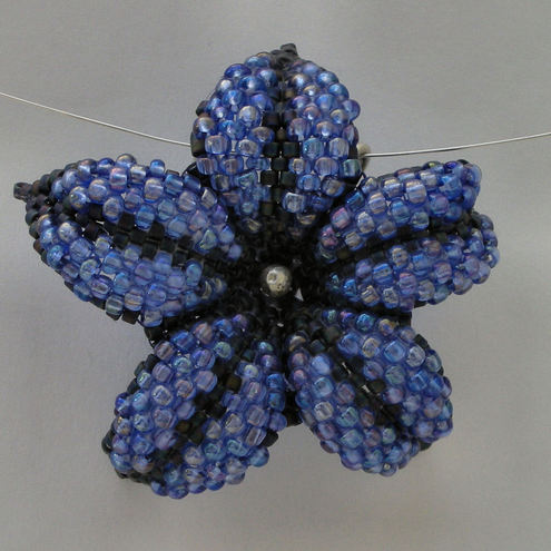 Blue beaded flower and sterling silver pendant