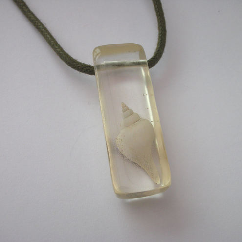 Fossil shell in resin pendant
