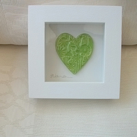 Sale Ceramic green heart impressed with a floral design, wood frame