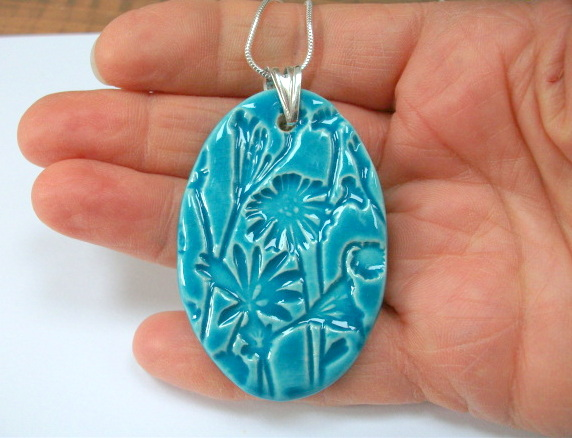 SALE Large ceramic oval pendant imprinted with a floral design - sterling silver