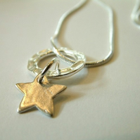 Sterling silver suspended star necklace