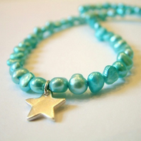 Aqua coloured freshwater pearl necklace with handmade Sterling silver charm