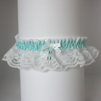 White lace wedding garter with aqua trim