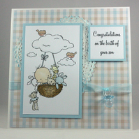 Handmade new baby boy card - baby in basket