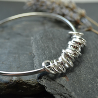 Bangle with ring charms