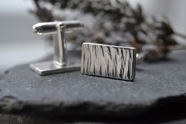 Silver bark textured cufflinks.