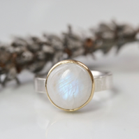 Moonstone and sterling silver ring with gold bezel setting.