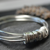 Three bangles with 21 ring charm