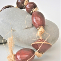 "Ceramic beads, hand-made, string of 10 beads ""Ox blood"""