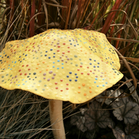 Yellow dotty ceramic garden mushroom, fairy toadstool with multicoloured spots