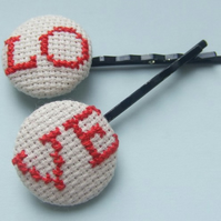 Pair of Cross-Stitch LOVE Hair Grips