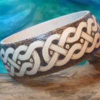 Wooden bangle decorated with a Celtic inspired design in pyrography