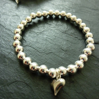 Silver Plated Bead Stretch Bracelet with Platinum Plated Heart Charm