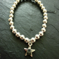 Silver Plated Bead Stretch Bracelet with 'Silver' Star Charm