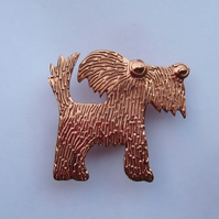 copper dog brooch