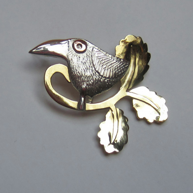 bird brooch with oak leaves