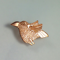 copper bird brooch