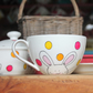 Bunny tea cup and saucer white bunnys and bright coloured spotted teacup
