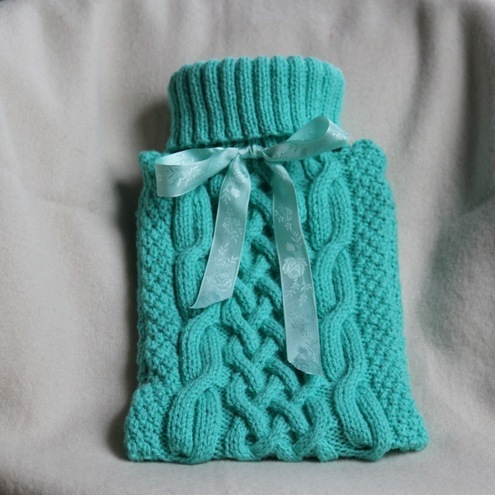 hand made, cable knitted hot water bottle cover