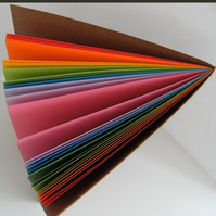 "Rainbow Notebook - 4"" x 6"" kraft cover notebook with bright pages."