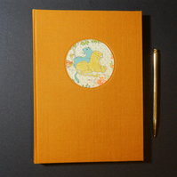 Persian Lions Journal or Notebook with saffron cloth covers. Hand made book.