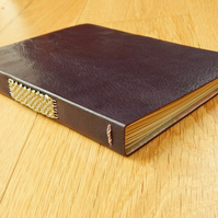 Aubergine Leather Journal with lined pages, gold & silver woven stitching.