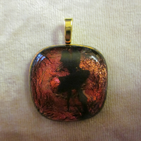 Handmade dichroic glass cabochon pendant - Lava with black enamel fairy