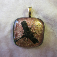 Handmade dichroic glass cabochon pendant - salmon with black enamel dragonfly