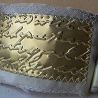 Victoriana sewn metal wristlet - brass love letter on cream damask