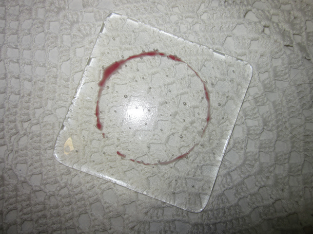 Fused glass coaster, red wine stain on clear