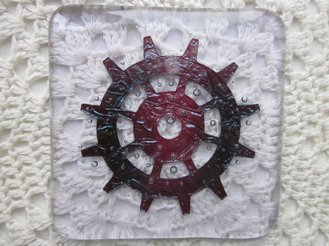 Handmade fused glass coaster - copper cog or ship's wheel on hint of purple tint