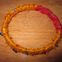 Textile bangle 'Strelitzia' small to medium - recycled sari silk