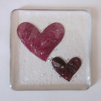 Handmade fused glass coaster - copper swirly hearts in clear glass