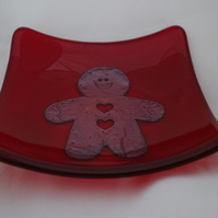 Hand made fused glass candy bowl - copper gingerbread man on red